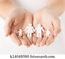 woman's hands with paper man family