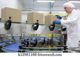 worker at packing line in factory