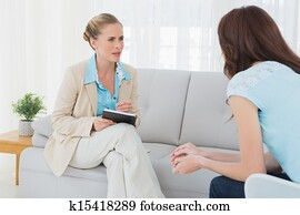 Attentive psychologist having session with her patient
