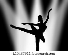 Ballet dancer under spotlight