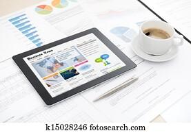 Business news website on digital tablet