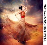 Dancing Fashion Woman wearing Blowing Long Chiffon Dress