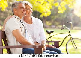 elegant mid age couple daydreaming retirement outdoors
