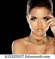 Fashion Beauty Girl Isolated on Black Background. Makeup. Golden Jewelry. Hairstyle. Vogue Style.