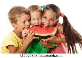 Happy family eating watermelon
