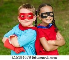 Kids pretending to be superheroes