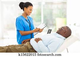 african female doctor consulting senior patient