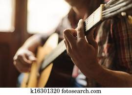 Creativity in focus. Close-up of man playing acoustic guitar