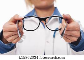 Female optometrist giving new glasses