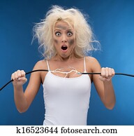Funny girl having problem with electricity. Electrical shock