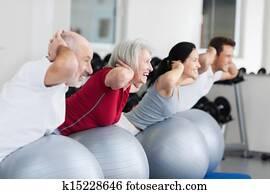Happy Family Exercising On Swiss Ball