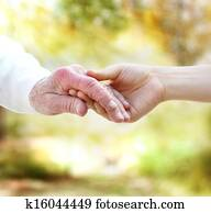 Holding hands with senior