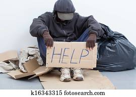 Homeless man sitting on a street
