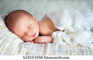 Little newborn baby boy 14 days, sleeps