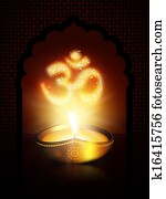 oil lamp with om sign over dark background