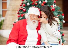 Santa Claus Listening To Girl's Wish