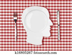 head dish or plate on red picnic tablecloth with knife and fork