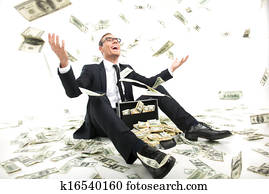 I am rich! Happy young businessman in formalwear throwing money up while sitting near the case full of paper currency