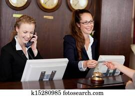 Two receptionists at a reception desk