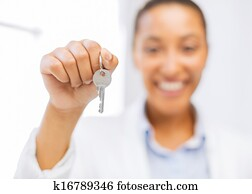 woman hand holding house keys