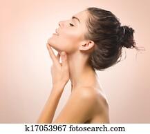 Beauty Portrait. Beautiful Spa Girl Touching her Face