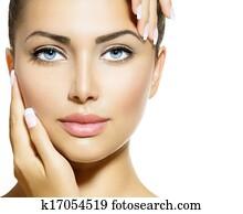 Beauty Portrait. Beautiful Spa Woman Touching her Face