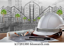 file of safety helmet and architect pland on wood table with sunset scene and building construction