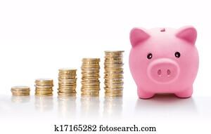 Piggy bank with euro coin stacks