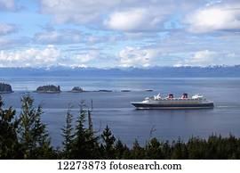 Disney Cruise Lines cruise ship Disney Wonder enters Tongass Narrows on Southeast Alaska's Inside Passage heading for Ketchikan, Alaska.