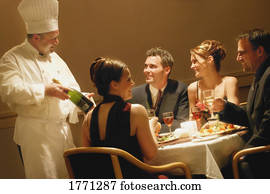 Couples having dinner in a restaurant