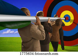 Businesspeople with arrow aiming at target