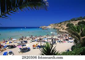 Tourists on beach, Cala Tarida Beach, Ibiza, Balearic Islands, Spain
