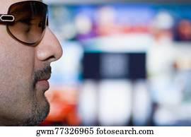 0d568a58a957 Close-up of a mid adult man peeking over his sunglasses Stock Photo ...