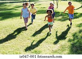 Children running in a park
