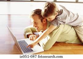 Father and son playing with a laptop