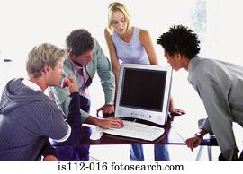 Men and woman using laptop computer