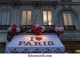 Collage of souvenir postcards on gift shop wall, Paris, Ile