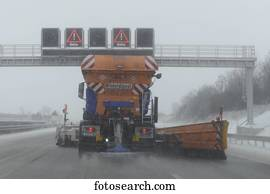 Winter services vehicle spreading salt on a motorway