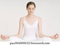 stock photo of nude woman sitting in lotus position eyes