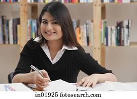 Woman in library, looking at camera