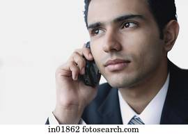 Young businessman using mobile phone, head shot