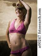 487ea9effdf Topless young woman wearing feathery bikini bottoms Stock Photograph ...