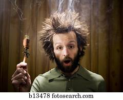 Man after electric shock with electric plug and smoke