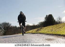 Man on black vintage road bike Stock Photograph | u24835136 | Fotosearch