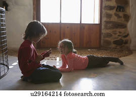 Brother And Sister Playing In Living Room