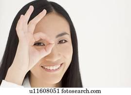 Woman Running Fingers Through Hair Stock Photo U16350118