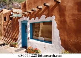 earthship adobe home house dog taos new mexico Stock Photo