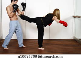 stock photograph of straight right hand punch of active tae bo and