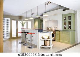 Bomba sgabelli in grande moderno cucina con rosso andato