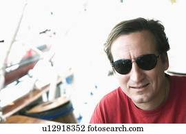 a84a877c2b07 Mid adult man wearing glasses, close-up Stock Photography   ky151025 ...
